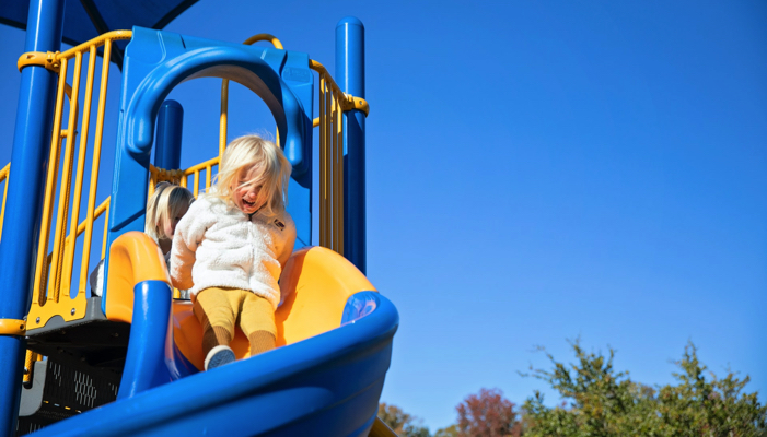 girl on a slide at the playground
